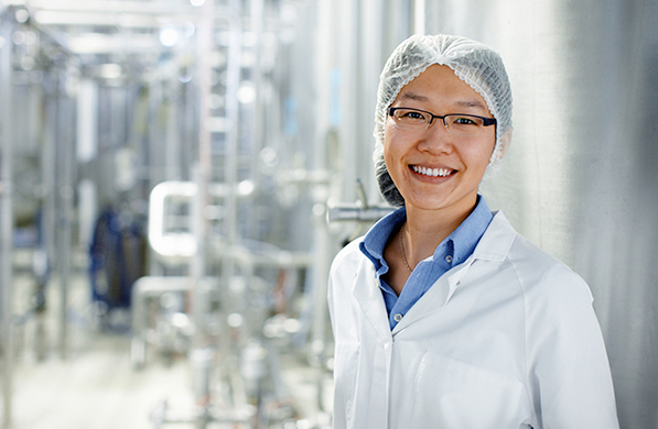 Woman smiling at Food & beverage plant