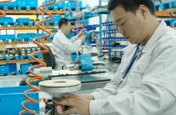 Manufacturing worker building a product
